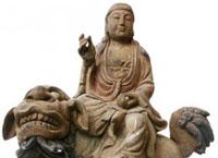 Будда Маньджушри едет верхом на льве